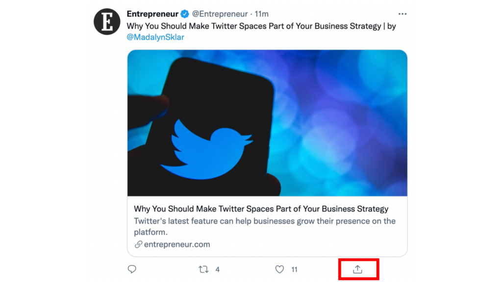 a screenshot of a tweet with the share button highlighted